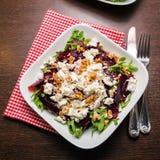 Beet salad with arugula, feta cheese and walnut Royalty Free Stock Photography