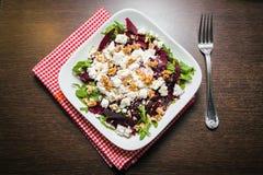 Beet salad with arugula, feta and walnut Royalty Free Stock Photo