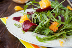 Beet salad with arugula and slices of orange Stock Photo