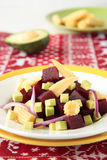 Beet salad with pickled maize and avocado Stock Photos