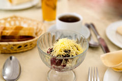 Beet salad with cheese and coffee on  table at restaurant Stock Photos