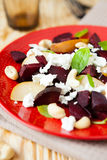 Beet salad with cottage cheese and cashew nuts Stock Images