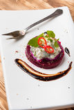 Beet salad with cottage cheese garlic herbs and chilli Stock Image