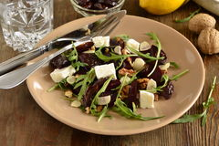 Beet salad with dried plums, walnuts, feta cheese, arugula Stock Photos