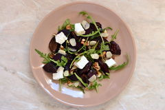 Beet salad with dried plums, walnuts, feta cheese and arugula Stock Image