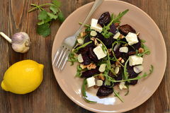 Beet salad with dried plums, walnuts, feta cheese and arugula Royalty Free Stock Photography