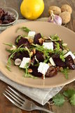 Beet salad with dried plums, walnuts, feta cheese and arugula Royalty Free Stock Photos