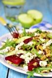 Beet salad with feta,apple,walnut and arugula. Stock Photos