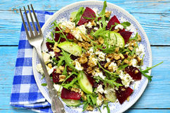 Beet salad with feta,apple,walnut and arugula. Top view stock photo