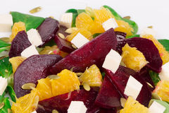 Beet salad with feta cheese and orange. Stock Photos