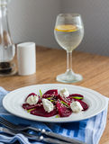 Beet salad with goat cheese, garlic and sesame seeds Stock Photos