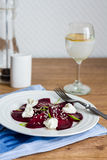 Beet salad with goat cheese, garlic and sesame seeds Stock Photography