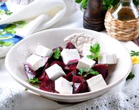 Beet salad and soft cheese with olive oil and parsley Royalty Free Stock Photography