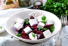 Beet salad and soft cheese with olive oil and parsley Stock Image