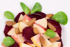 Beet salad with spinach and minced apple. Royalty Free Stock Images