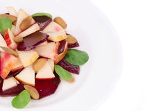 Beet salad with spinach and minced apple. Stock Photos