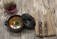 Beet  salad and tomato, red pepper soup, sauce with olive oil, rosemary and smoked paprika with fork and knife on a wooden backgro Stock Image