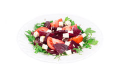 Beet salad with tomatoes and feta cheese. Stock Image