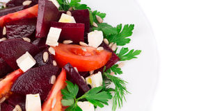 Beet salad with tomatoes and feta cheese. Stock Images
