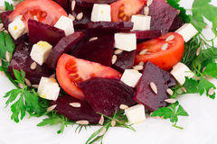 Beet salad with tomatoes and feta cheese. Royalty Free Stock Image