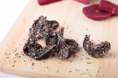Beet slices, dried with salt, garlic and herbs Royalty Free Stock Images