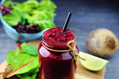 Beet smoothie with fresh herbs. Lime and whole beets Stock Photo