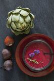 Beet soup with artichoke royalty free stock photography