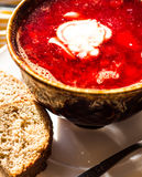 Beet soup with beans and sour cream, garlic, slices of bread Stock Photo