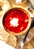 Beet soup with beans and sour cream, garlic, slices of bread Stock Photography
