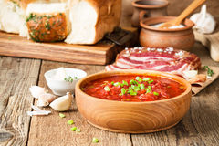 Beet soup borscht  with garlic buns and cured pork belly, Ukrain Royalty Free Stock Photo