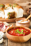 Beet soup borscht  with garlic buns and cured pork belly, Ukrain Royalty Free Stock Image