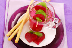 Beet soup with cream and grissini stock images