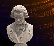 Beethoven bust and music  notes. Mable bust of Ludwig van Beethoven,German composer on dark background with musical notes Stock Photography
