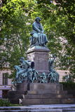 Beethoven monument on the Beethovenplatz square in Vienna, Austria. Beethoven monument on the Beethovenplatz square with lots of trees in Vienna, Austria stock images