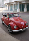 Beetle. Red Volkswagen Beetle parked in driveway Royalty Free Stock Image