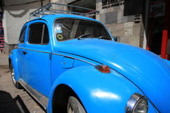 Beetle. Old version of vw beetle in blue royalty free stock photos