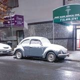 Beetle in Brooklyn. Buggy, Volkswagen, gray, classic car Royalty Free Stock Photo