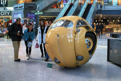 Beetle Sphere. This photo was taken in a shopping mall of Beijing.Images of the crowd is a circular beetle car, this is a real car, the designer make it a round Stock Image