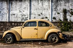 Beetle yellow car abandoned stock images