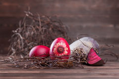 Beetrood easter eggs. Natural easter egg dyeing red with beetroot Royalty Free Stock Photography