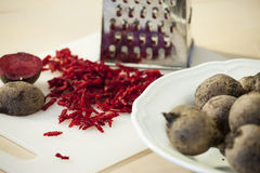 Beetroot. On a cuttingboard, Some of the s are grated and there is a grater in background Stock Photography