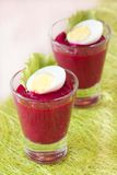Beetroot, beet cream salad, mousse with eggs in shot glass Stock Photo