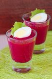 Beetroot, beet cream salad, mousse with eggs in shot glass Stock Image