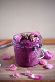 Beetroot and blueberry Ice cream or smoothie bowl, jar, with seed crackers and rose petals Royalty Free Stock Image