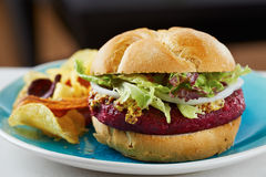 Beetroot burger on white bread Royalty Free Stock Image