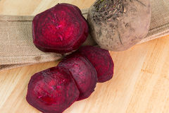 Beetroot on burlap and wooden desk Royalty Free Stock Images