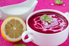 Beetroot cream soup with seeds. Beetroot cream soup with sunflower seeds and lemon Royalty Free Stock Photo