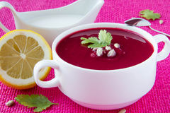 Beetroot cream soup with seeds. Beetroot cream soup with sunflower seeds and lemon Royalty Free Stock Image