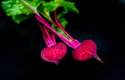 Beetroot cut in half on a dark background, place for text, healthy food stock photography