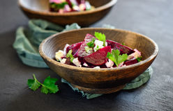 Beetroot and feta salad. On a dark wooden table Royalty Free Stock Photo